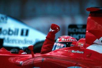 Michael Schumacher, celebrates the 150th GP victory for the Ferrari team