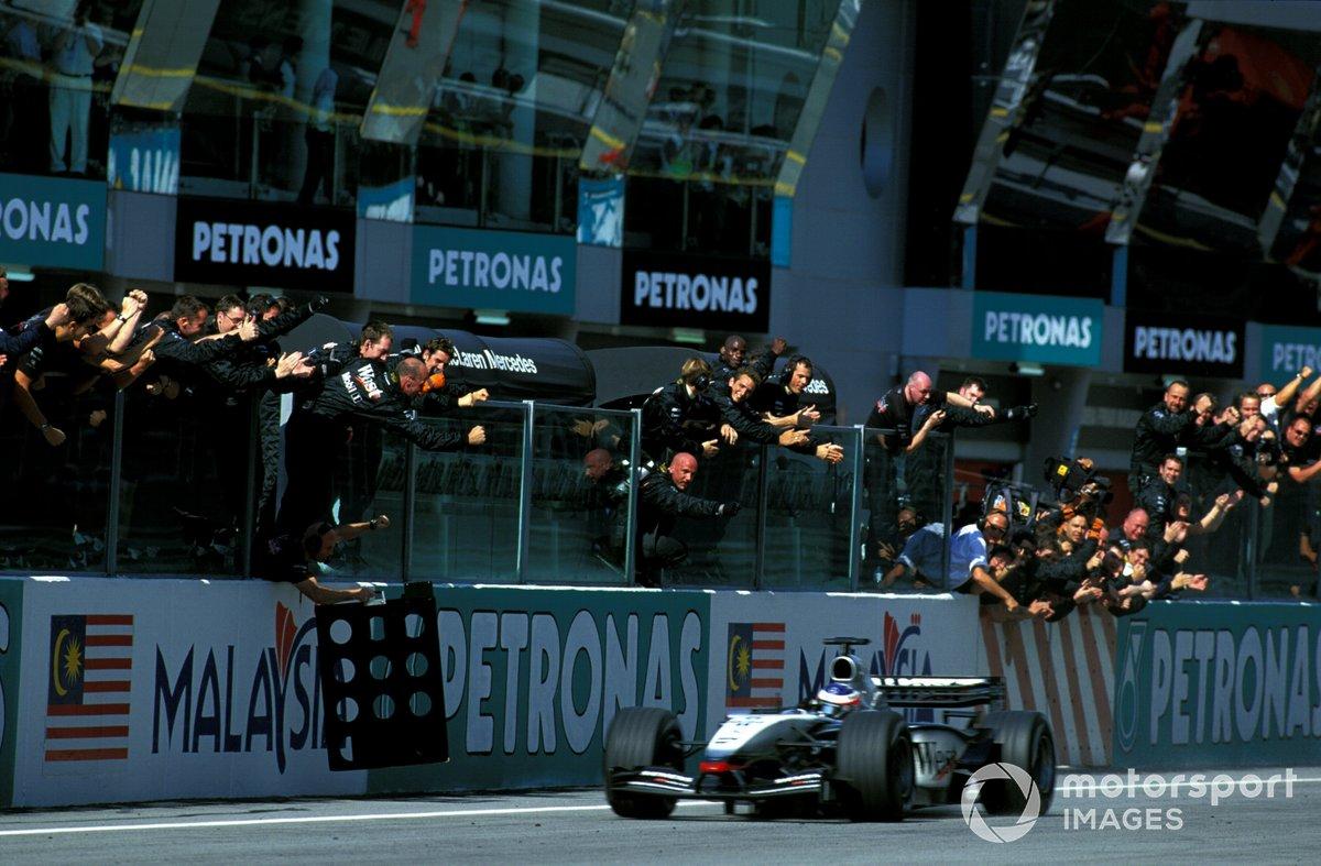 Kimi Raikkonen , McLaren Mercedes MP4/17D, crosses the finishing line to take his debut F1 win