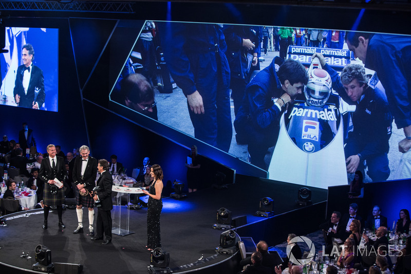 Nelson Piquet receives a lifetime achievement award from Gordon Murray