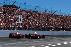 Michael Schumacher, Ferrari F2004 passes team mate Rubens Barrichello, Ferrari F2004
