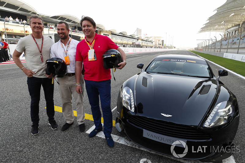 David Coulthard poses with Peter Phillips and James Martin, in front of an Aston Martin Vanquish S