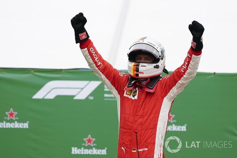 Sebastian Vettel, Ferrari, 1st position, celebrates on arrival in Parc Ferme