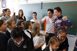 Dani Pedrosa and Marc Marquez, Repsol Honda Team with the school class