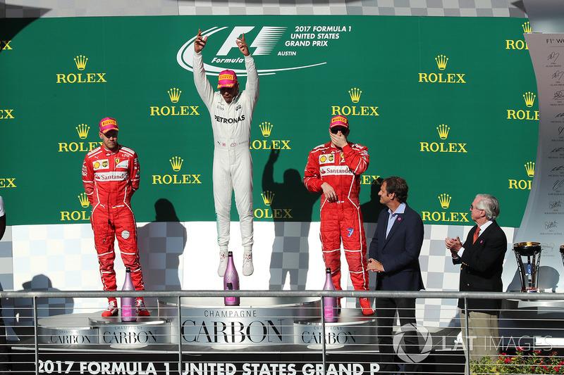 Подиум: победитель Льюис Хэмилтон, Mercedes AMG F1, второе место – Себастьян Феттель, третье место –