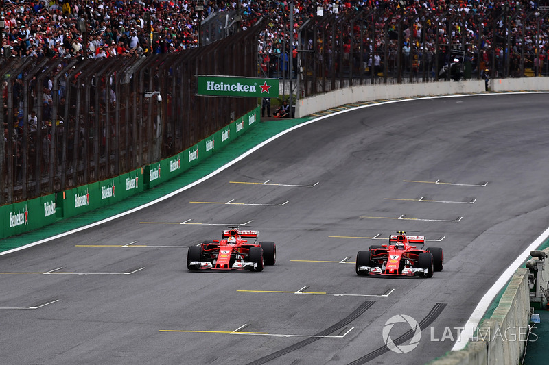 Sebastian Vettel, Ferrari SF70H and Kimi Raikkonen, Ferrari SF70H stop on the track after Qualifying