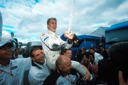 Race winner Johnny Herbert, Stewart Grand Prix celebrates with his crew