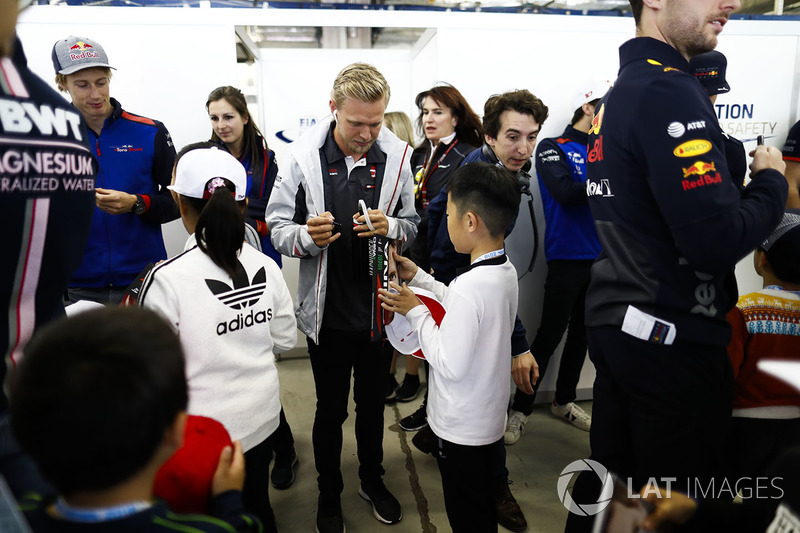 Kevin Magnussen, Haas F1 Team, signs an autograph for a young fan