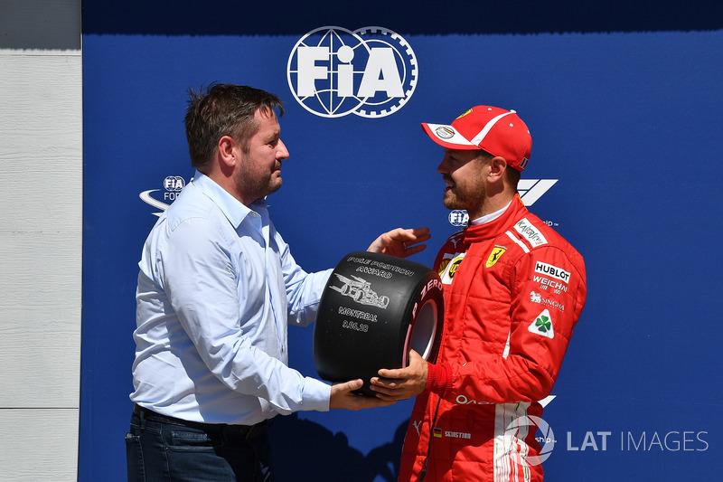Sebastian Vettel, Ferrari receives the Pirelli Pole Position Award from Paul Hembery, Pirelli Motorsport Director