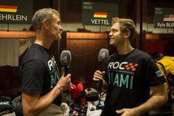 David Coulthard and Sebastian Vettel, talk for the media