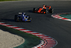 Marcus Ericsson, Sauber C36, leads Fernando Alonso, McLaren MCL32
