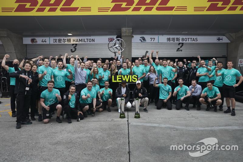 Lewis Hamilton, Mercedes AMG, celebrates victory with Valtteri Bottas, Mercedes AMG and team members