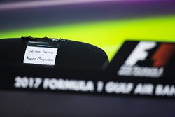 Name labels for Sergio Perez, Force India, and Kevin Magnussen, Haas F1 Team