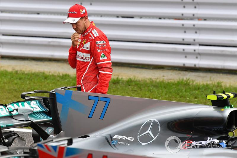 Sebastian Vettel, Ferrari looks at Mercedes-Benz F1 W08  in parc ferme