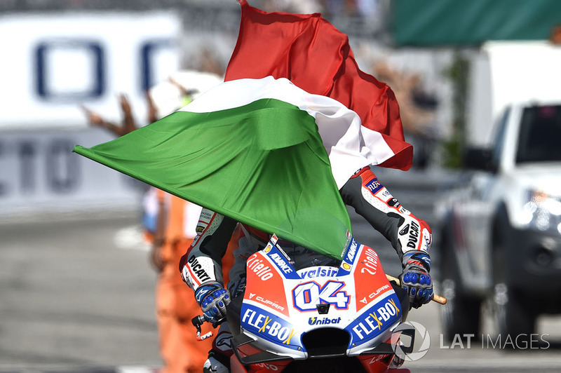 Race winner Andrea Dovizioso, Ducati Team with the italian flag