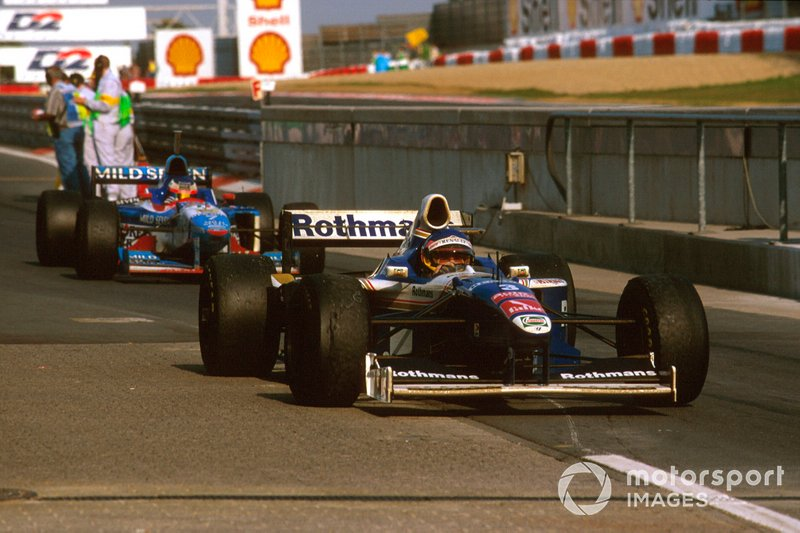 Jacques Villeneuve, Williams FW19 Renault arrives at parc ferme, Jean Alesi, Benetton B197 Renault behind