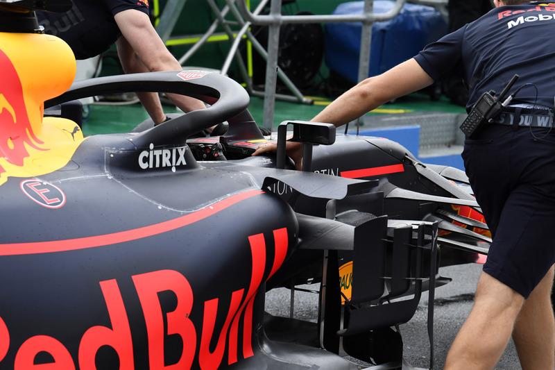 Red Bull Racing mechanics push Red Bull Racing RB14 in pit lane