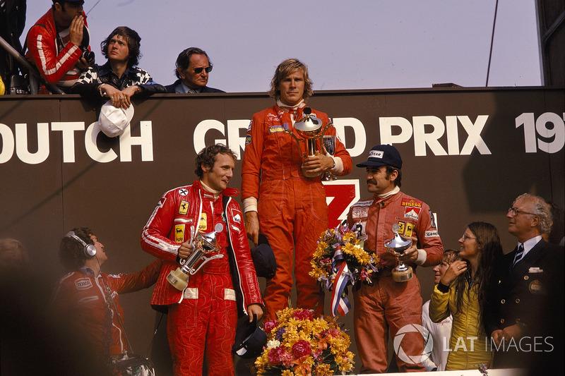 James Hunt, Hesketh, 1st position, Niki Lauda, Ferrari, 2nd position and Clay Regazzoni, Ferrari, 3rd position, on the podium