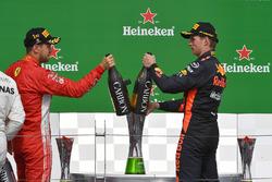 Sebastian Vettel, Ferrari and Max Verstappen, Red Bull Racing celebrate on the podium with the champagne