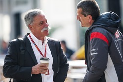 Chase Carey, Chief Executive Officer and Executive Chairman of the Formula One Group and Guenther Steiner, Haas F1 Team Principal