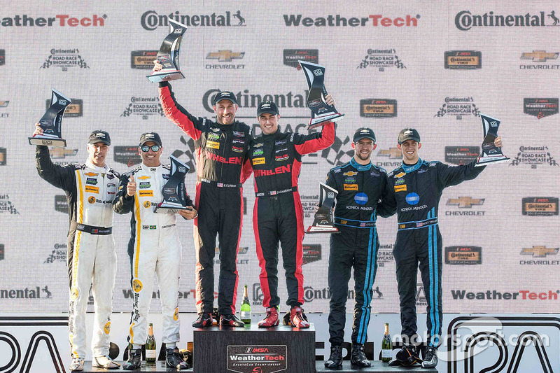 Overall podium: winners Eric Curran, Dane Cameron, Action Express Racing, second place Christian Fit
