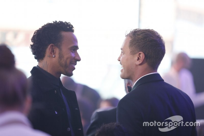 Sebastian Vettel, Ferrari with Lewis Hamilton, Mercedes-AMG F1