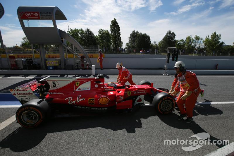 Sebastian Vettel, Ferrari SF70H, gets a push back from some marshals