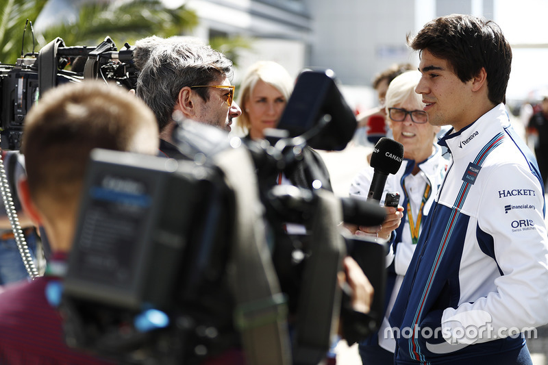 Lance Stroll, Williams, is interviewed by the media