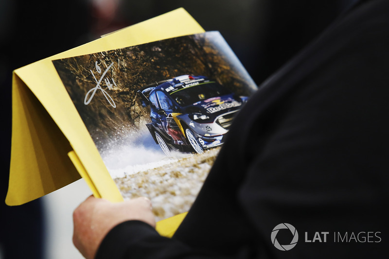 A fan admires a signed Ford WRC print