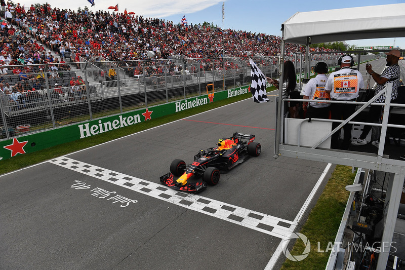 Max Verstappen, Red Bull Racing RB14 takes the chequered flag waved by Winnnie Harlow (CDN)