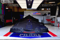 Scuderia Toro Rosso STR13 under covers in the garage