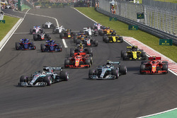 Lewis Hamilton, Mercedes AMG F1 W09, leads Valtteri Bottas, Mercedes AMG F1 W09, Kimi Raikkonen, Ferrari SF71H, Sebastian Vettel, Ferrari SF71H, Nico Hulkenberg, Renault Sport F1 Team R.S. 18, Pierre Gasly, Toro Rosso STR13, Brendon Hartley, Toro Rosso STR13, and the rest of the field at the start of the race