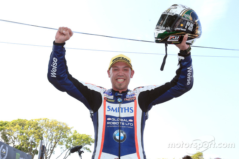 Peter Hickman celebrates after winning the RL360º Superstock TT race