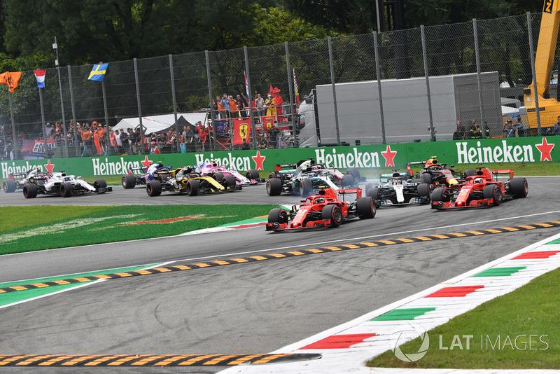 Kimi Raikkonen, Ferrari SF71H leads Sebastian Vettel, Ferrari SF71H and Lewis Hamilton, Mercedes AMG F1 W09 at the start of the race