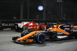Stoffel Vandoorne, McLaren MCL32, passes the crashed car of Sebastian Vettel, Ferrari SF70H