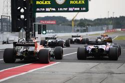 Pierre Gasly, Scuderia Toro Rosso STR12 and Fernando Alonso, McLaren MCL32