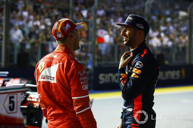 Pole sitter Sebastian Vettel, Ferrari, third place Daniel Ricciardo, Red Bull Racing