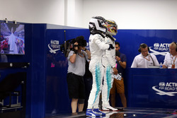Lewis Hamilton, Mercedes AMG F1 and Valtteri Bottas, Mercedes AMG F1 in parc ferme weigh-in area