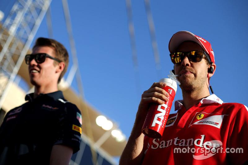 Sebastian Vettel, Ferrari and Daniil Kvyat, Red Bull Racing