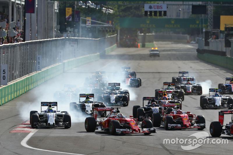 Felipe Massa, Williams FW38 y Sebastian Vettel, Ferrari SF16-H en el incio de la carrera
