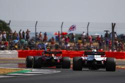 Max Verstappen, Red Bull Racing RB14, leads Romain Grosjean, Haas F1 Team VF-18