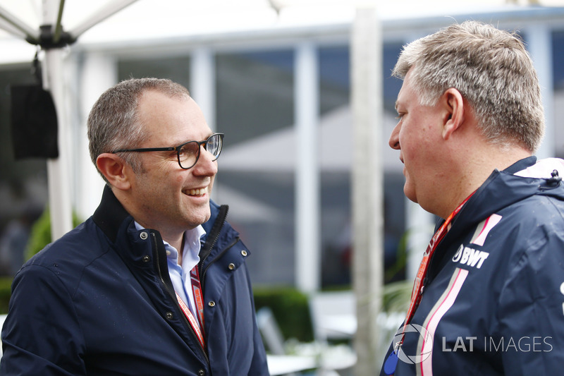 Stefano Domenicali and Otmar Szafnauer, Chief Operating Officer, Force India, in the paddock