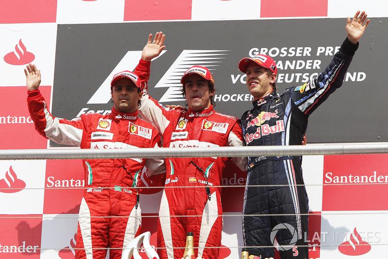 Podium: tweede plaats Felipe Massa, Ferrari met racewinnaar Fernando Alonso, Ferrari en derde plaats