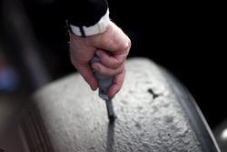 A Pirelli tyre technician checking tyre temperatures