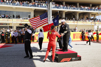 Sebastian Vettel, Ferrari, greets the National Anthem singer
