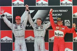 Podium: winner Mika Hakkinen, McLaren, second place David Coulthard, McLaren, third place Michael S