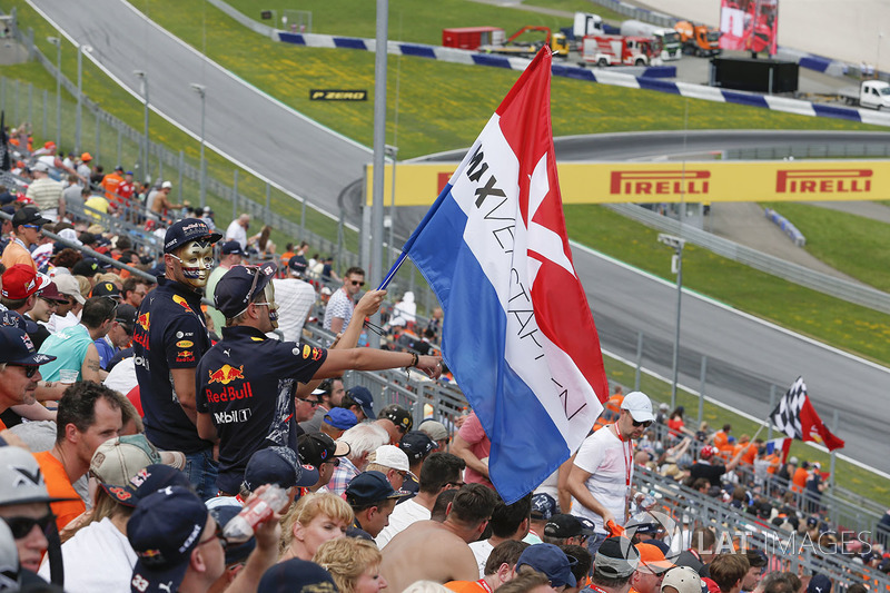Max Verstappen, Red Bull Racing fans and flags in the grandstand
