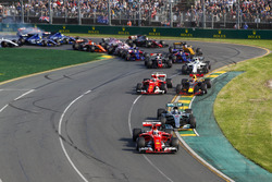 Sebastian Vettel, Ferrari SF70H, leads Valtteri Bottas, Mercedes AMG F1 W08, Kimi Raikkonen, Ferrari SF70H, Max Verstappen, Red Bull Racing RB13, and the remainder of the field through the first corner