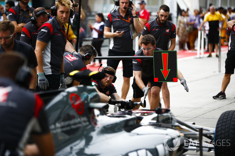 Engineer sat in the cockpit of the Haas F1 Team VF-17 for a practice pit stop