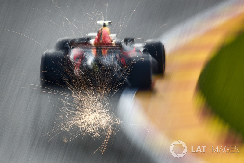 Sparks fly from the rear of Max Verstappen, Red Bull Racing RB13