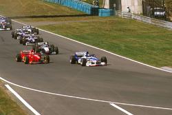 Damon Hill, Arrows A18 Yamaha, Eddie Irvine, Ferrari F310B and Mika Hakkinen McLaren MP4/12 Mercedes